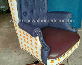 Custom order- upholstered wingback office chair with button tufted back, leather seat and African Mud Cloth. SOLD- Custom order available.