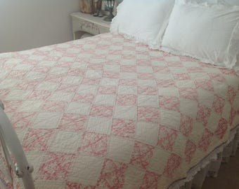 Beautiful antique hand sewn pink and white quilt