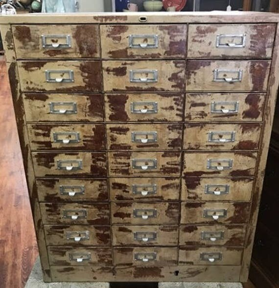 Rustic sorting cabinet with 27 drawers