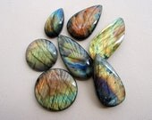 Reserved for Valerie. 7 natural labradorite gemstone / crystal cabochons of different colors, shapes, and sizes.