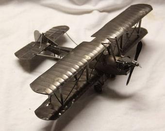Miniature airplane bi-pane novelty figurine.  All metal