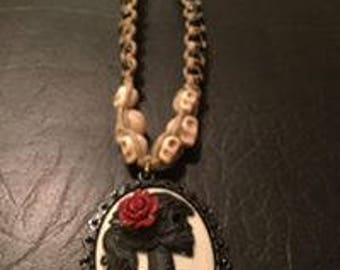 Hemp necklace with skull cameo pendant, glass skulls, and beads