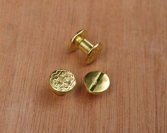 Pair of Floral Patterned Chicago Screw Bolts Brass