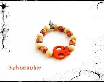 Bracelet and orange skull beads