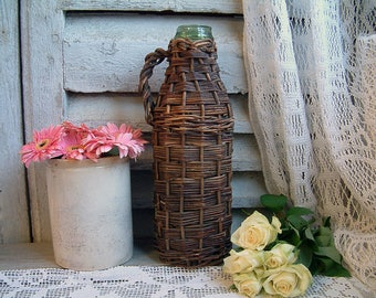 Antique french green glass truffle bottle in wicker basket. Green glass truffle jar. French country. Jeanne d'Arc living.