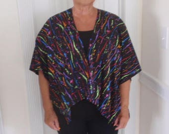 black cape with multi colored splotches
