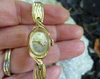 ladies bulova watch, gold tone watch, wind up watch, swiss