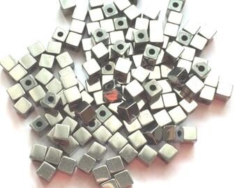 Shiny silver metal cube bead