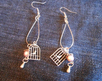 Silver buckles, birdhouse, pale pink beads