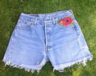 Weathered vintage Levi's jean shorts size 28-32 customized US ethnic floral stripe