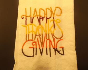 "Dish towel with ""Happy Thanksgiving"" embroidered on it."