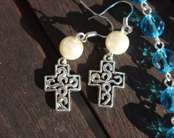 White beads and cross earrings