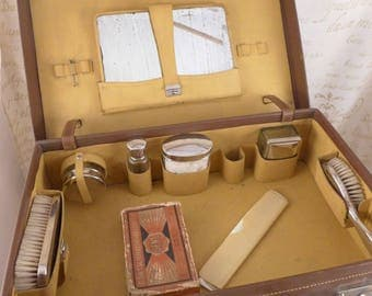 Men's shaving kit in a suitcase