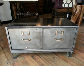 Vintage industrial repurposed stripped steel file cabinet coffee table with glass feet