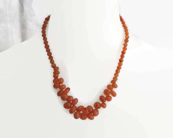 Vintage Carnelian beads necklace in orange-red color, oval and round beads with decorative central section