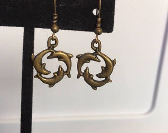 Silver or brass swimming dolphin earrings
