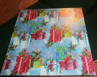 Vintage Christmas gift wrapping paper in original box colorful blue pink 14 uncut sheets Santa angels candles bell garland mailbox plus more