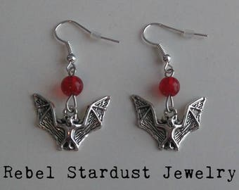 Bat earrings with a red bead