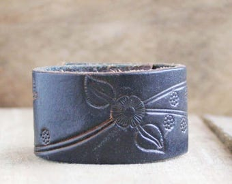 CUSTOM HANDSTAMPED black leather cuff with flower design by mothercuffer