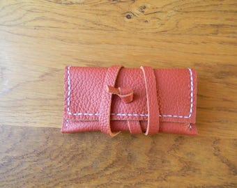 CB leather pouch orange closure strap