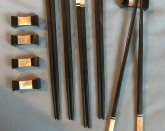Handmade, Vietnamese Ebony Chopsticks, with striped brown shell accents and matching pillow top rests. Set of 5