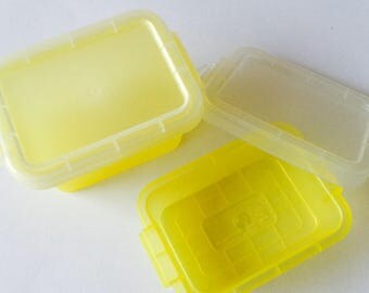 10 mini transparent yellow plastic boxes