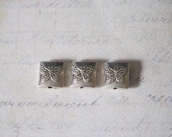 3 rectangular beads and Butterfly embossed silver-plated 10x9mm