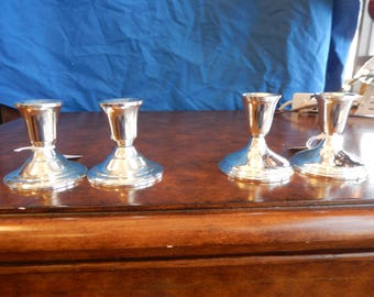 Two pair of Sterling Silver Candle Holders
