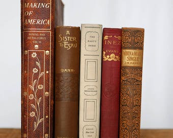 Red gold brown white antique books - stack of books for decor and design gold fancy spines
