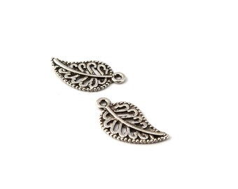 Sold by 2 antique silver leaf charms