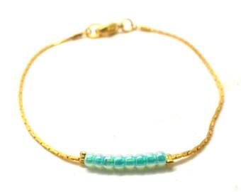 Gold minimalist bracelet, sky blue round beads
