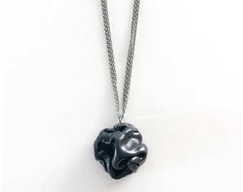 """Black clay """"rosette"""" on triple strand necklace - inspired by what Heidi Klum was wearing on Project Runway!"""
