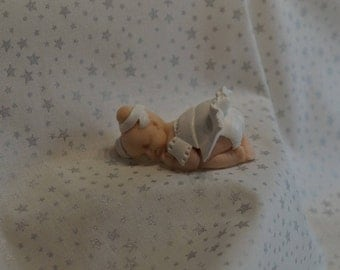 polymer clay baby dressed in white