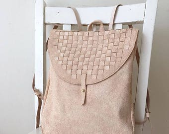 Small hand-woven leather backpack