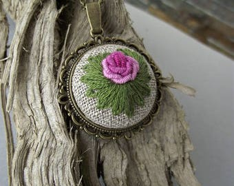 Pendant with hand embroidered rose