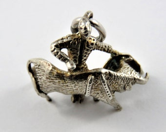 Bull Charging Through Matadors Cape Sterling Silver Pendant or Charm.Tested July 10th