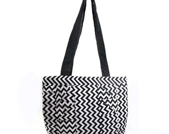 Black and white zigzag tote bag purse with spotted interior and black base