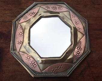 Antique handmade mirror with copper detail