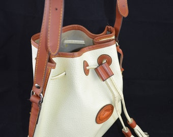 Vintage Dooney & Bourke Leather Crossbody Bucket Bag in White and Tan