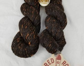 Black and orange blended huacaya alpaca yarn