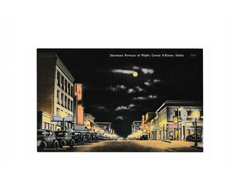 Coeur d'Alene Idaho 1930s Vintage Postcard, Sherman Avenue at night