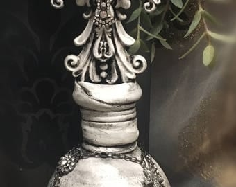 Antique white decorative bottle with cross