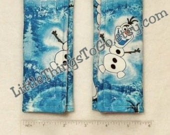 Car seat strap covers from Frozen Olaf fabric. Reversible. 100% cotton facing. Stroller straps or seat belt covers. Girl /boy. Thinner.