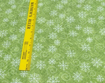 Riverwoods Collection-The Blizzard Bunch-Snowflakes on Green Cotton Flannel Fabric from Troy Corp.