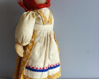 Vintage cloth costume doll, 21cm, cloth body, plastic face and hands, wooden legs.