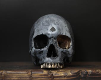 One-Eyed Ace - Weathered White & Black Full Scale Life Size Realistic Faux Human Skull Replica with Gold Detailing / Art / Ornament / Decor