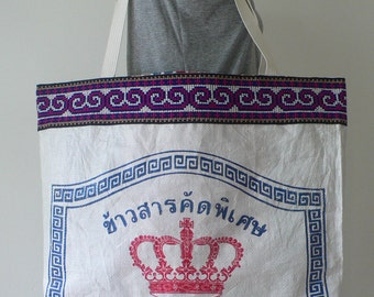A large upcycled tote shopping bag handcrafted from a recycled rice bag