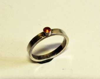 Sterling Silver ring with orange topaz of 3 mm