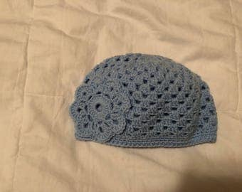 hand crocheted adult's blue cloche hat with flower detail