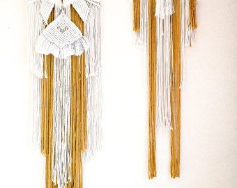 Wall hangings, cream and mustard